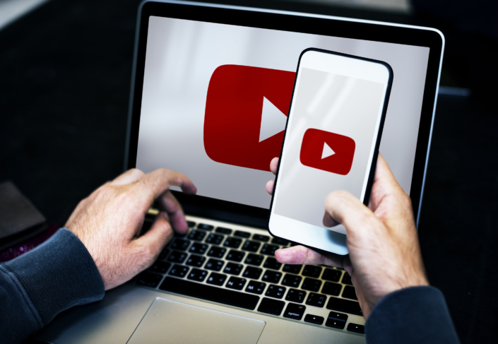 YouTube on laptop and cellphone